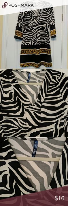 White Mark Black/White Dress Medium Black and white dress in zebra print with leopard print bands around bottom and sleeves.  White House Couture Collection. Medium. Gently worn. White Mark Couture Dresses