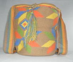 $113 US Dollars or 83 Euros. Includes International Shipping. Each wayuu bag (mochila) takes 4 days to be knitted. Whatsapp +57 3154833188. Pin: 7a85e20e. Catalog in: www.artemalu.com