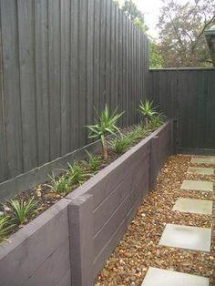 Painted fence & treated pine retaining wall   Kate Ashton Landscape Design - Melbourne