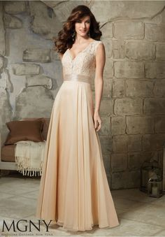 Evening Gowns and Mother of the Bride Dresses by MGNY Lace and Beading on Chiffon Matching Stole. Available in Champagne, Black