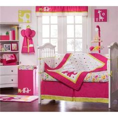 Bright 4-piece crib set with polka dots and elephants. Cute!