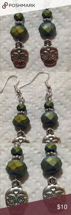 Green Glass Sugar Skull Earrings These cool earrings are made with iridescent green glass beads and features silver tone sugar skulls. All PeaceFrog jewelry items are made by me! PeaceFrog Jewelry Earrings