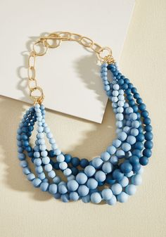 Burst Your Bauble Necklace in Sky. Everyone will be amazed with your fashion finesse when they witness the addition of this tri-toned blue necklace to your ensemble. #blue #modcloth