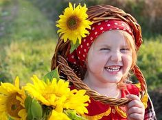 a girl, a basket and sunflowers