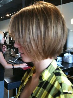 Cute slightly shaggy chin length bob with long layers