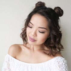 @thy.time is adorable in this curled lob with mini double buns. She used the NuMe Pearl Wand to get these long lasting cute curls