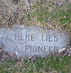 """Here Lies A Pioneer"" old grave marker in Watertown, MA of colonial graves"