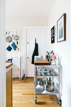 """Looking into the kitchen from the entryway. Elijah says one of the biggest challenges in his apartment are the walls: """"The walls of my apartment are apparently Bisquick held in place with paint, so any project involving hanging something on the walls is a nail-biter."""""""