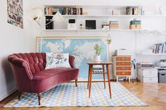 living room. love the pop of velvet and world map... and everything else