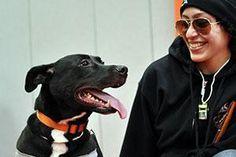 black dog with smiling woman http://www.aspca.org/pet-care/virtual-pet-behaviorist/dog-behavior/desensitization-and-counterconditioning