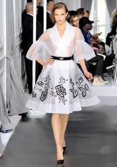 Bill Gaytten for Christian Dior: Spring 2012 Couture -- he was thinking about transparency versus opacity, of clothes having to be perfect enough to be held up to intense scrutiny, and of floral embroidery that gradated from placement stitches to only-in-Paris-could-you-see-this-level-of-craftsmanship, a commentary on the brilliance of the work needed to conjure up couture. -- Vogue