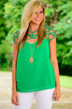 This top is so cute! We love the bright green color and the lattice style neckline! This light material is on point for the summer!