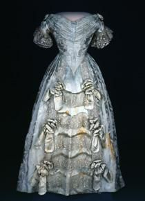 Sarah Polk first wore this light-blue brocaded silk dress woven with a design of poinsettias in the late 1840s. It was remade as an evening gown, probably for her niece, in the 1880s.