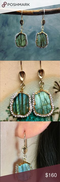 """Labradorite pave earrings Handcrafted using ocean-blue labradorites, these iridescent slab earrings take 'shimmer' to the next level. A crystal outline finish makes these peices utter showstoppers. Stones may vary due to their natrual quality. 1.5"""" Labradorite pave with Swarovski And gold trim hanging on a silver hooks. Matana Jewelry Earrings"""