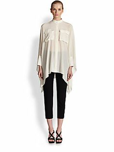 Alexander McQueen - Crepe de Chine Voluminous Blouse with slim high-waisted capris and black sandals.  Great S/S look - so elegant, easy and minimal.