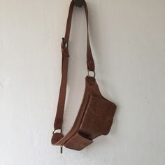 Traveling this summer? Perhaps you'd like to do so in style. The Kech Belt Bag in Natural is super fun and lightweight, and you'll be setting trends!