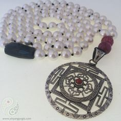 108 Swarovski Pearls enhanced by Sterling Silver & Coral Mandala