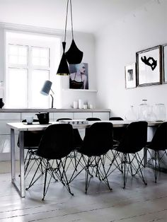 A darker, moodier take on Scandinavian style. | #Eames plastic molded chairs with wire base | Archpad