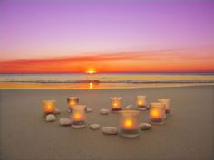Candles on the beach at sunset, in tribute to the victims of the shooting in Newtown, CT.