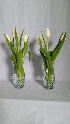 Check out this item in my Etsy shop https://www.etsy.com/listing/271144896/vase-set-2-glass-blue-green-black-hand