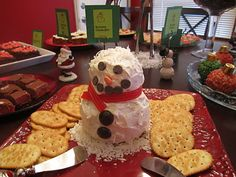 DIY Cheese snowman perfect for Christmas Open house party. Recipe from Betty Crocker . I've made this several times and each time people always think it's too cute to eat. Then I'll notice all that's left is his head. ha ha