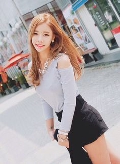 Cutout top, mini skirt and some pretty accessories are the basics for putting together an ulzzang Korean look.  -Lily. #koreanfashion