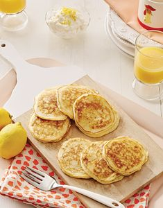 These light and airy Ricotta Pancakes taste so good and are so easy to make. Adding purchased or homemade ricotta cheese to this morning classic gives a luxurious creaminess to your flapjacks. Simply top your stack with butter and maple syrup, and you'll want to whip up this recipe for every meal. Ricotta Pancakes, Pancakes And Waffles, Crepes, Brunch Recipes, Breakfast Recipes, The Pancake House, Brunch Party, Savory Breakfast, African Recipes