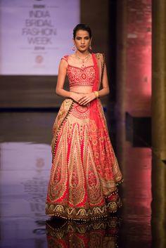 Beautiful pink and gold Indian wedding paneled lehnga by JJ Valaya at India Bridal Fashion Week.