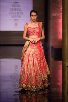 Beautiful pink and gold Indian wedding paneled lehnga by JJ Valaya at India Bridal Fashion Week. More here: http://www.indianweddingsite.com/bmw-india-bridal-fashion-week-ibfw-2014-jj-valaya/
