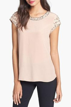 """A simple silhouette with a glamorous update featuring fancy embellishment of sparkly grommets and studs along the neckline and sleeves. The back features an elegant draping making this the perfect date night tee. Colour is nude.    Measurements: Length: 25"""" from shoulder, Sits 2"""" below waist   Tee With Embellishment by Rebecca Taylor. Clothing - Tops - Tees & Tanks Clothing - Tops - Short Sleeve Canada"""