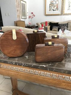 Beautiful wooden clutch, elegant and unique.in four different styles: Round clutch, square clutch measures 6 x6 x 2 , oval clutch: 7 x 10 x 1.5. Rectangular Clutch 7 x 4.5 x 2.5