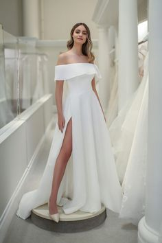 Off the shoulder, Ivory A line organza dress with front skirt overlap opening with ruffle feature at the neckline. Michelle Roth | Style: Kendall Michelle Roth Wedding Dresses, Long Wedding Dresses, Bridal Dresses, Off Shoulder Wedding Dress, Wedding Dress With Pockets, Minimalist Wedding Dresses, Organza Dress, Cute Wedding Ideas, Wedding