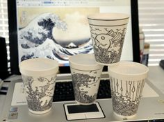 Waves and water are a frequent theme in the foam cup and napkin artwork of Cheeming Boey. He credits some of his inspiration to the art seen in background of Katsushika Hokusia, who worked in Japan in the late 1700s.