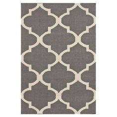 Bring breezy Moroccan inspiration to your home decor with this flatweave rug, showcasing a handcrafted quatrefoil motif.   Product:...