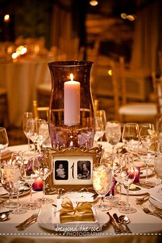Having a picture of the bride and groom at the age of the table number- fantastic wedding idea!