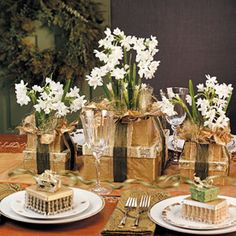 Blooming Gift Boxes...Delicate paperwhites in gold wrapping paper highlight these beautiful holiday wedding centerpieces or Christmas table decorations, by Taste of Home