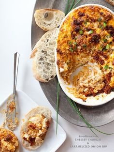 Cheesy chorizo and caramelized onion dip. I made this with sausage instead if chorizo. Served it at a holiday party and everyone really liked it