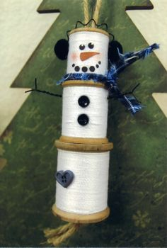 Snowman - Made with three wooden spools. Wrapped with crochet thread.