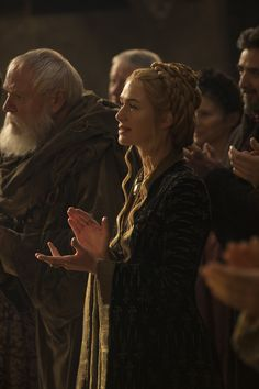 Season five Margaery and Tommen wedding Cersei in black dress, with fleur de lis style dagger pattern