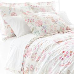 A vintage Italian fabric served as the inspiration for this stunning printed cotton duvet cover in shades of pink, red, blue, and green.