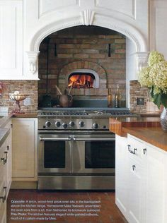 Wood-fired pizza oven in range backsplash I think this is SO COOL, but you'd have to watch out not to burn your armpits when you reach for a pizza. I'd figure it out, though. Love it.