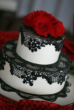 white with red roses and black lace wedding cake