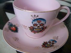 I would love to have a china hutch with these tea cups inside.  Too pretty to even use!
