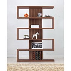 Bring contemporary style into the den or office with this Karrise Display Shelf, bookcase, room divider. The airy design and plentiful storage of this bookshelf make it a welcome accent anywhere in the house.