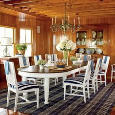 Big table for lots of friends and family, beautiful wood walls and ceiling with a nautical flair.