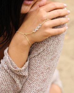 A gorgeous finger to cuff bracelet lined with gems - perfect for any beach goddess!