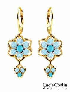 Dangle Flower Earrings by Lucia Costin with Turquoise and Light Blue Swarovski Crystal Flowers Surrounded by Twisted Lines, Set with Lovely Charms; 24K Yellow Gold over .925 Sterling Silver Lucia Costin. $59.00. Earrings by Lucia Costin. Unique jewelry handmade in USA. Update your everyday style with inspiration when wearing this piece of jewelry. Wonderfully designed with turquoise and aquamarine Swarovski crystals. Splendid combination of dangle elements