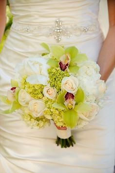 Lush peonies , cymbidium orchids and roses
