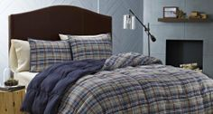 Mad for plaid? Plaid bedding set with blue, brown and other colors.