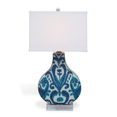 """Scalamandre Maison by PORT 68Name: Greystone Indigo Lamp 30""""H SKU: LPAS-232-02, Size: 16"""" x 11.5"""" x 30""""H 3 way switch. 100 watt max bulb. Brass hardware. Clear cord.   Shade: (16"""" x 11"""") x 11.5"""" SH. Hardback rectangle shade. Single fold trim. Off white fabric. Shade includes soft rolled edge fabric top diffuser.   Materials: ceramic, lucite, brass"""